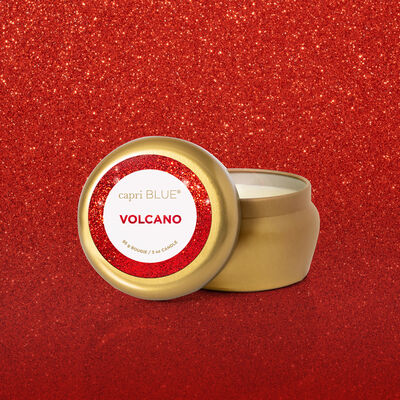 Volcano Glam Mini Candle Tin product with glam background