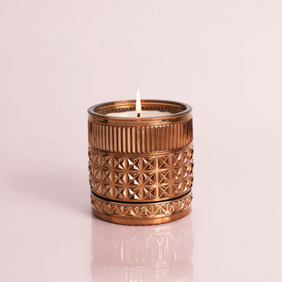 Dark Vanilla and Sandalwood Faceted Jar 11 oz, product view when lit