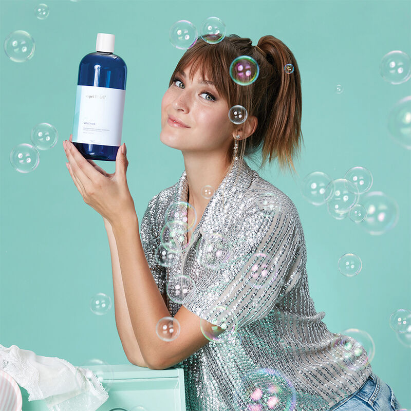 Volcano Concentrated Laundry Detergent product in use with model image number 3